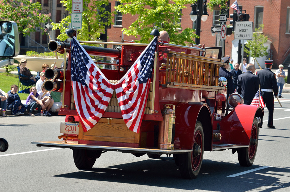 Vintage fire engine with american flags.